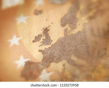 Brexit concept. Shallow focus on euro banknote macro detail showing a map of Europe with focus on Great Britain.