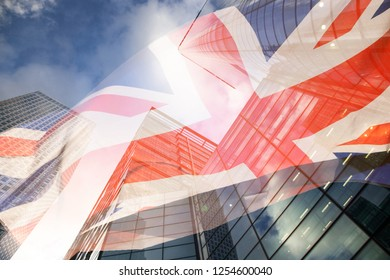 brexit concept - UK economy after Brexit deal - double exposure of flag and Canary Wharf business center skyscrapers