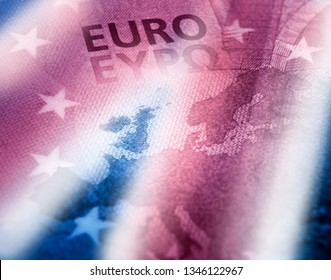 Brexit concept. Unfocused Euro banknote close up detail of Europe map with focus on Great Britain. British colors flag effect over Europe map.