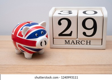 Brexit date 29th march on calendar with union jack piggy bank