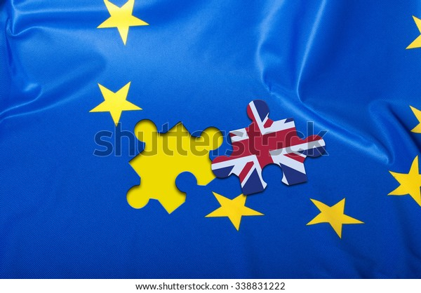 Brexit - Detail of Silky Flag of European Union With Puzzle Piece of Great Britain