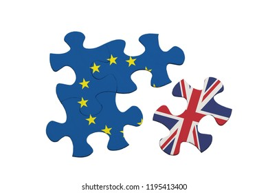 Brexit - Jigsaw pieces showing the United Kingdom separated from the European Union isolated on white background;
