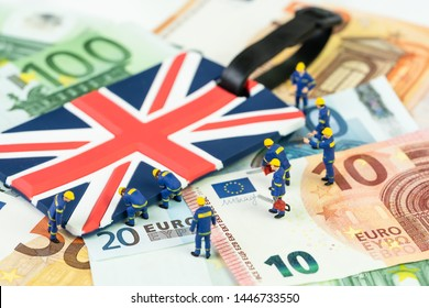Brexit negotiation plan or Euro zone withdrawal concept, miniature figures worker help move UK Union jack flag from pile of Euro banknotes money.