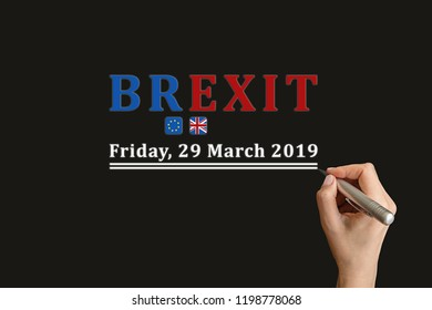 Brexit Text written by woman hand on blackboard. UK exit UE on 29 March 2019.