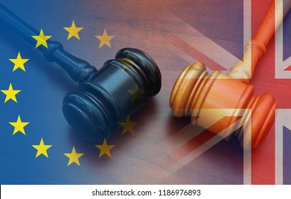 Brexit UK EU legal concept, different position theme with wooden judge gavels on table and flags