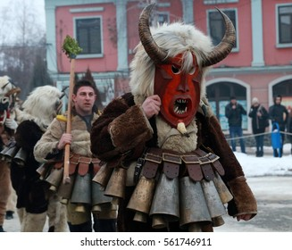 Breznik, Bulgaria - January 21, 2017: Unidentified man with traditional Kukeri costume are seen at the Festival of the Masquerade Games Surova in Breznik, Bulgaria.
