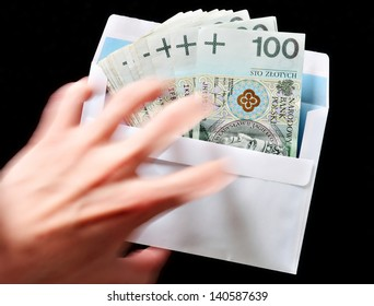 Bribery concept envelope with money and a reaching hand