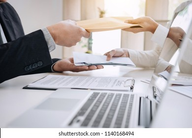 Bribery and corruption concept, bribe in the form of dollar bills, Businessman giving money while making deal to agreement a real estate contract and financial corporate.