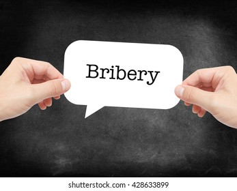 Bribery written on a speechbubble