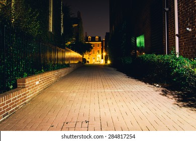 Brick alley at night in Fell's Point, Baltimore, Maryland.