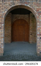 Brick archway and a wooden antique door make for a lovely photo for many applications, ideas, and concepts about anything for entering doors in our lives or closing doors.