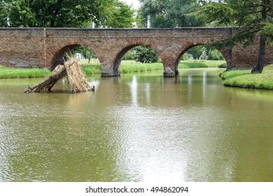 brick bridge over pond