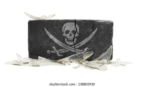 Brick with broken glass, violence concept, pirate flag