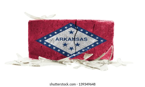 Brick with broken glass, violence concept, flag of Arkansas