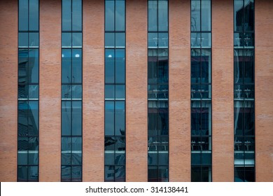 Brick Building Facade with a Blue Glass for Texture.