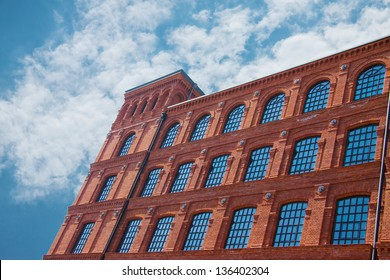 Brick building with windows on sky background - Shutterstock ID 136402304