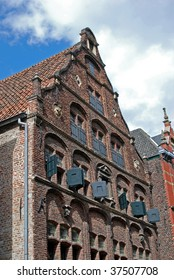 Brick building with wooden painted shutters dated 1588 in Venlo, Netherlands