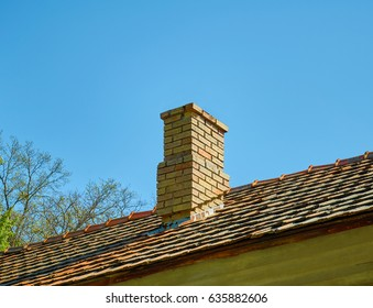 brick chimney against the blue sky