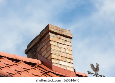 brick chimney against the sky