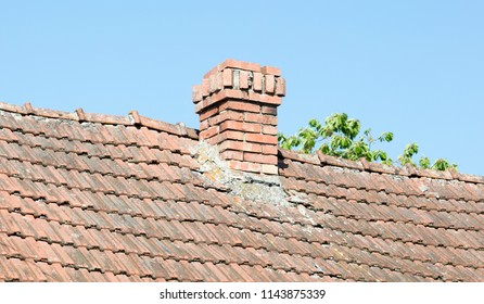 Brick chimney of an old house in Romania