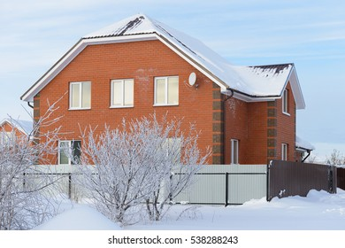 brick country house with a garden in winter