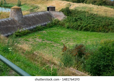 Brick dam and grass field in Veere, The Netherlands