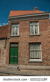 Brick facade of house in typical style of the Flanders's region in street of Bruges. With many canals and old buildings, this graceful town is a World Heritage Site of Unesco. Northwestern Belgium.