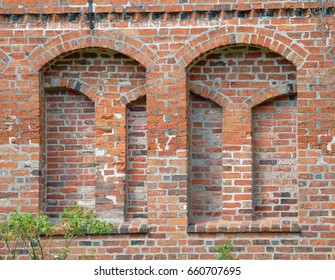 Brick face of a building with round arches