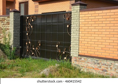 Brick Fence With Gate Of Modern Style Design Decorative Brick Wall Surface  With Cement. Metal