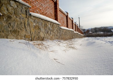 Brick fence in winter