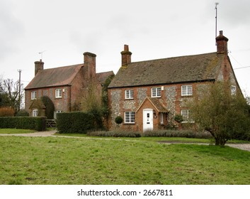 Brick and Flint Cottages on an English Village Green