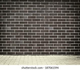 Brick grunge weathered wall background with walkway
