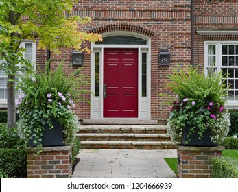 brick house with maroon colored front door