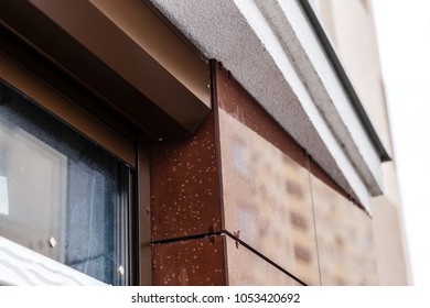 Brick house windows with rolling shutter for house protection