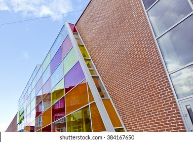 Brick modern shopping center with colored stained glass windows in the city of sunny clear day