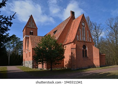 brick neo-gothic Catholic church of Our Lady of Gietrzwałd, erected at the beginning of the 20th century, in the village of Kociołek Szlachecki in Masuria, Poland - Shutterstock ID 1945511341