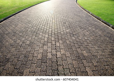 Brick octagona  walkway and green grass lawn in perspective view