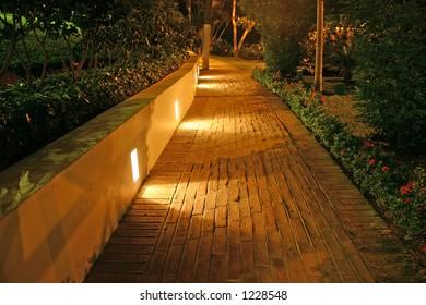 Brick path walkway at night