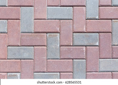 Brick pavement tile, top view. Urban texture as background.