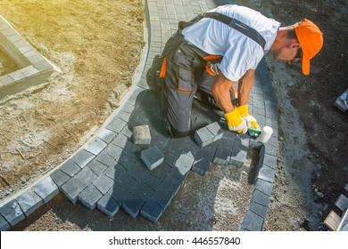 Brick Paving Works. Professional Caucasian Worker Building Block Paved Hardstanding Garden Path