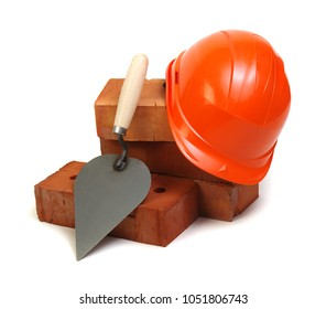 Brick, red hard hat and tools isolated on white background
