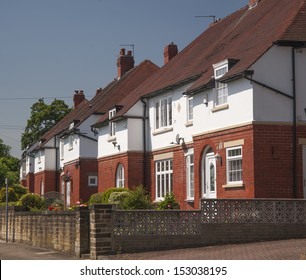 brick and render middle class housing