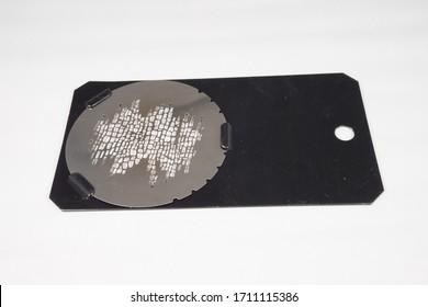 Brick size B metal gobo in a gobo holder