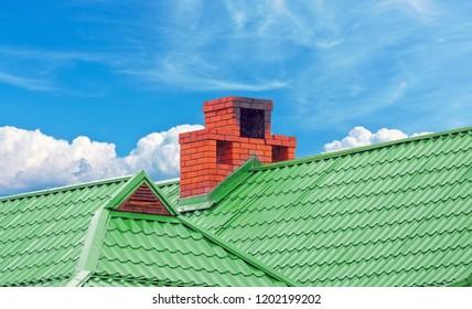 brick smokestack on background of blue sky
