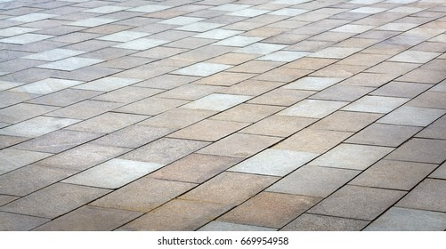 Brick stone sidewalk, pavement texture in diagonal perspective