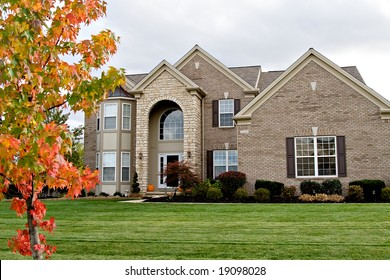 A brick and stone suburban home - nice landscaping.