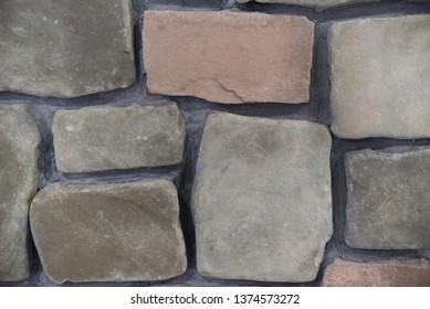 The brick texture with cracks and scratches can be used as a background. Natural photo.