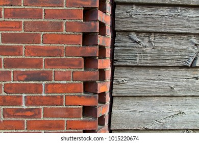 brick wall adjoining rustic wooden building