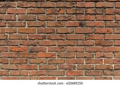 Brick Wall.  An aged and patched, multi-textured brick wall for backgrounds or presentations.