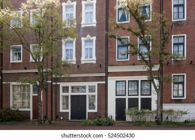 Brick wall apartment with beautiful trees.